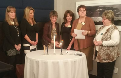 Barbara Hall leading the candle lighting ceremony